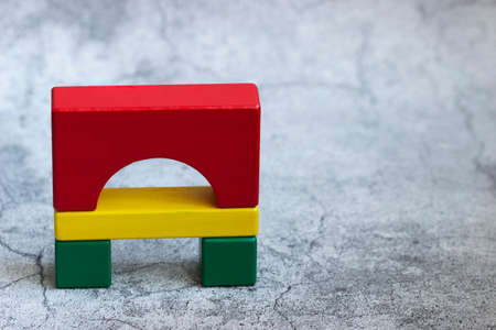 Colorful wooden details of the constructor on a gray background.