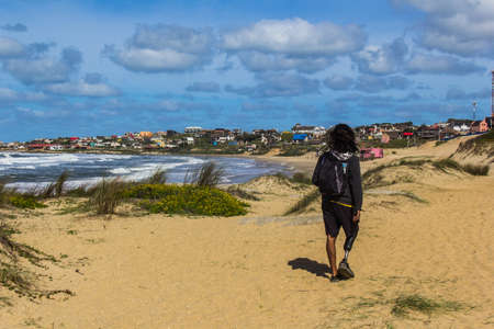 Man in beach in Punta Del Diablo - Uruguay Stock Photo