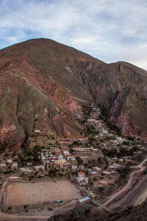View of Iruya village and multicolored mountains in the surroundings at sunset, Salta province, Argentina, iruya - San Isidro - San Juan treeking Imagens