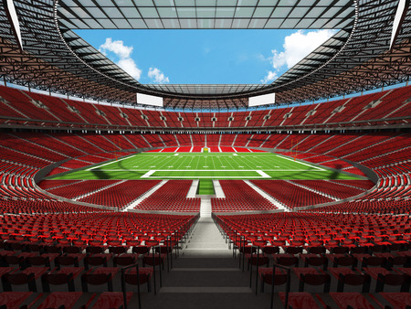3D render of a round football stadium with read seats, VIP boxes open roof and blue sky Stock Photo