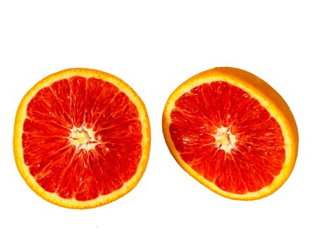 Top view of half cutted red bloody orange. Isolated fruit on white background.