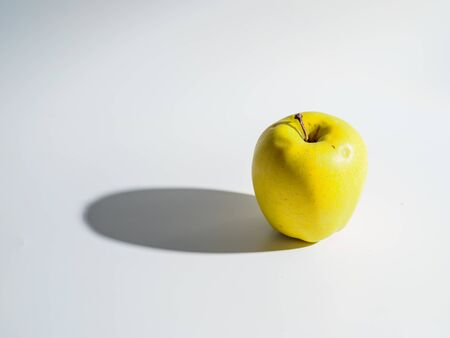 Organic green apple isolated on white background.