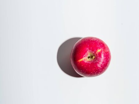 Top view of organic red apple isolated on white background.
