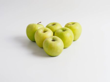 Organic green apples isolated on white background.