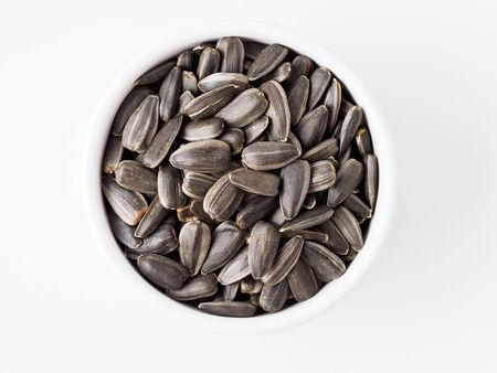 Sunflower seed isolated on white background. Seed in the small plate. Copyspace for text. Stok Fotoğraf