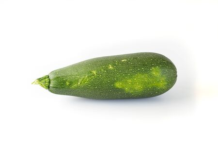 Fresh zucchini isolated on white background. Big green zucchini with shadow and copyspace for text. Stok Fotoğraf