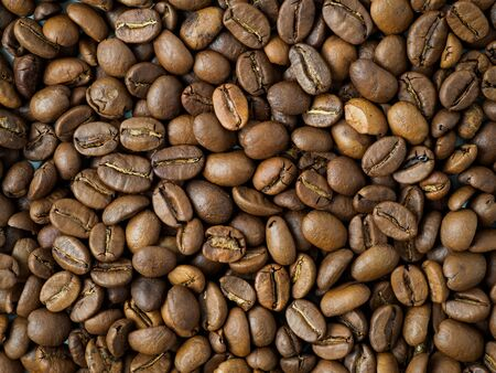 Carpet of roasted coffee beans. Mix of arabica and robusta beans in closeup view. Stok Fotoğraf