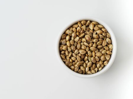 Seeds of hemp, isolated on white background. Copyspace for text.
