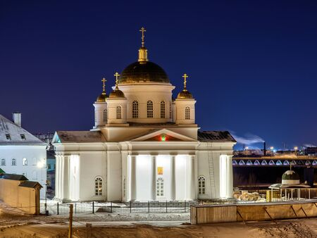 Orthodox church in Nizhny Novgorod. Night view of beautiful cathedral with citylights on the background.