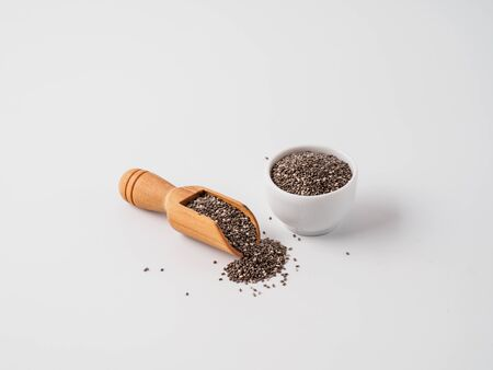 Chia seeds isolated on white background in different dishes. Copyspace for text. Stok Fotoğraf