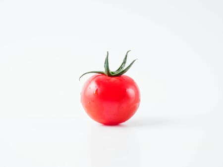 Fresh cherry tomato isolated on white background. Copyspace for text.