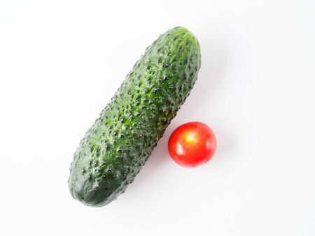 Tomato and cucumber isolated on white background. Copyspace for text.