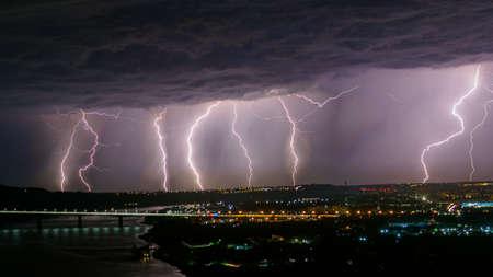 Lightning storm over the city. Imagens