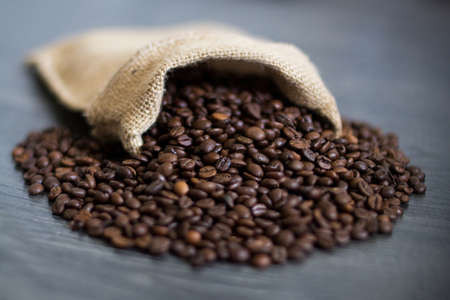 seed: the coffee grains which are pouring out from a bag