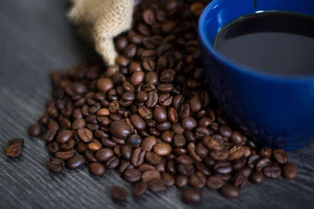 seed: A cup of coffee on coffee beans