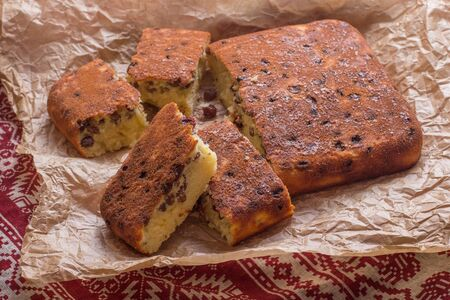 traditional pattern: Homemade semolina cake with raisins in rustic style Stock Photo