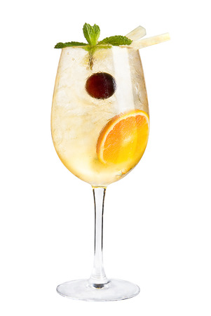 Cocktail with citrus and maraschino cherry for decoration on a white background, isolated