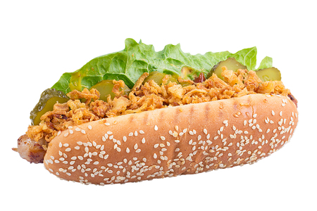 Hot dog with fresh bun with sesame and fresh greens on white background, isolated