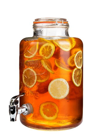 Fresh citrus lemonade with lemons in beverage dispenser, isolated