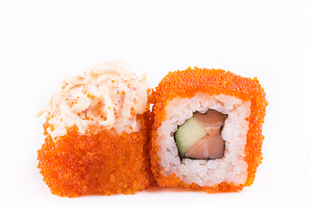 japanese Cuisine, Sushi Set: sushi and sushi rolls in caviar with salmon and cucumber on a white background. isolated.