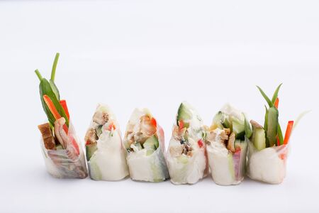hoisin: Spring rolls with vegetables served on a white background. isolated.