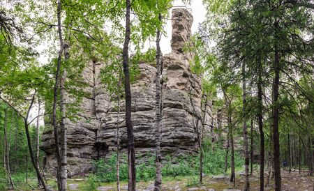 A stone remains in the forest. The nature of the southern Urals. Wild places. Stone giant.