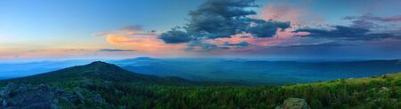 urals: Sunset over the mountainous terrain. The nature of the Southern Urals. Sunset sky over the forest and the mountains. Panoramic view
