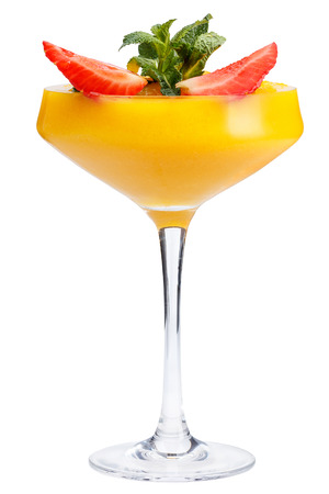 Refreshing fruit cocktail. A refreshing drink with a mango pulp, decorated with strawberries and mint. isolated