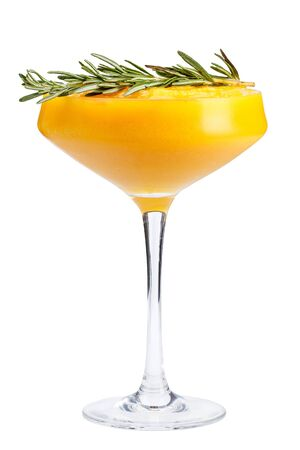 Refreshing fruit cocktail. A refreshing drink with a mango pulp, decorated with rosemary. isolated