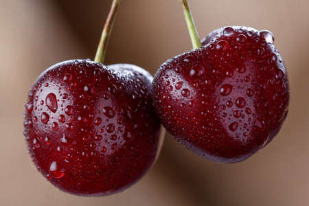 Bright juicy cherry berries on a baggy background.Country style.