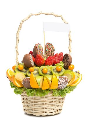 celebration: Basket with fruits and berries in chocolate isolated on white background. Handmade. Strawberries and citrus, apple, kiwi. Gift basket with fruits and sweets.