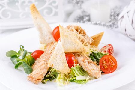 The original serving of Caesar salad with delicious crispy croutons. Close-up. Reklamní fotografie