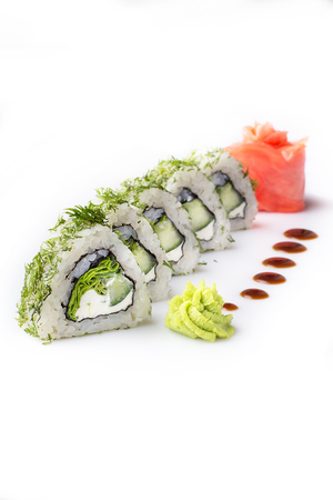 Sushi roll turned on a white background. Sushi Japanese food in a restaurant. Japanese restaurant menu. Roll with pieces of cucumber and Philadelphia cheese. Isolated. Stok Fotoğraf