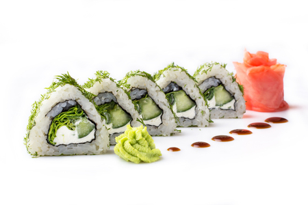 Sushi roll turned on a white background. Sushi Japanese food in a restaurant. Japanese restaurant menu. Roll with pieces of cucumber and Philadelphia cheese. Isolated. Stock Photo