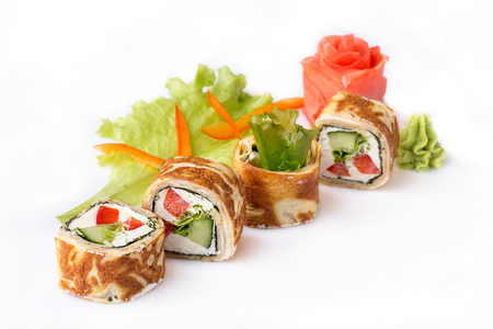 Sushi roll turned on a white background. Sushi Japanese food in a restaurant. Japanese restaurant menu. Roll in an omelette isolated on white background.