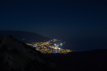 Stunning views of the night city from Mount Ai-Petri peninsula Crimea. Mountain landscape.