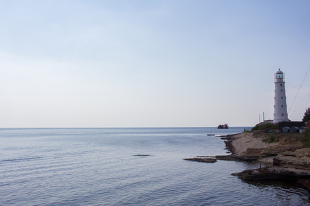 Stunning views of the sea and a lighthouse located on the coastal strip. Landscape.