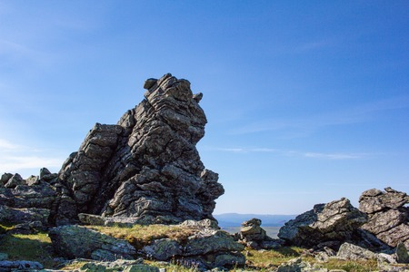 Stones of the Northern Ural. Taiga. Large boulders and stone remnants of the oldest mountains on the planet. Ural mountains.