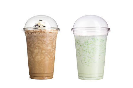 Delicious fruit smoothies in plastic cups, on a white background. Two milkshakes with different flavors. Isolated