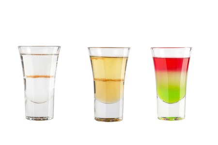Set of alcohol shots on a white background. Three shots with different types of alcohol. Isolated. 写真素材