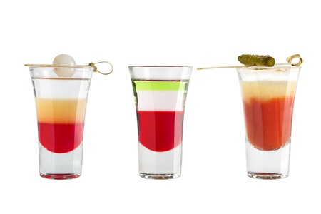Popular alcohol shots on a white background. Three shots strong alcohol and decoration. Isolated.