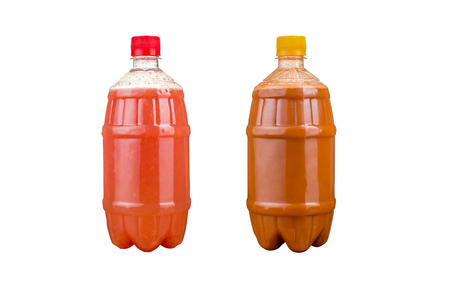 Two plastic bottles with colorful natural juices. Variations of drinks. Isolated.