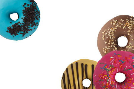 Different bright tasty donuts on a white background. Place under the text. Diversity. Close-up.