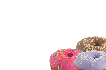 Different bright tasty donuts on a white background. Place under the text. Diversity. Close-up. Stockfoto