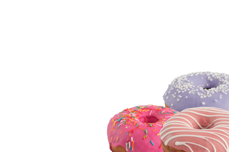 Different bright tasty donuts on a white background. Place under the text. Diversity. Close-up. 免版税图像 - 122032546