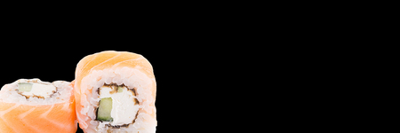 Classic sushi roll. Sushi at black background.Japanese seafood sushi , roll a black background. Banner.