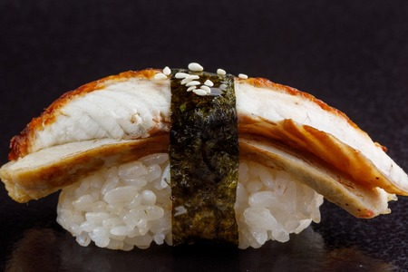 Classic sushi roll. Sushi at black background.Japanese seafood sushi , sushi a black background. Macro.