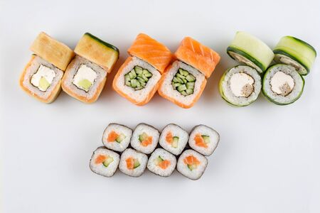 Classic sushi roll sets. Sushi on a white background. Japanese sushi seafood roll white background. Close-up. Isolated. Stock Photo