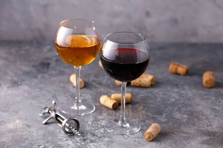 Glasses of white and red wine. The concept of winemaking. Place under your text. Still life on a textural background. Close-up. Stok Fotoğraf