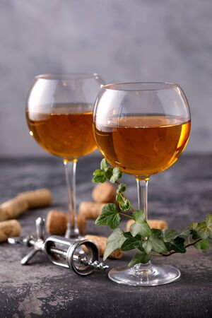 Two glasses with white wine on a textural background. Copy space. Place for your text. Close-up. 免版税图像
